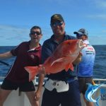 Ben with red emperor with stuart and andrew photo bombing Montebello Islands WA fishing Charter Blue Lightning Charters