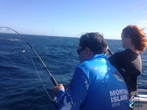 Fishing Charter rod in hand